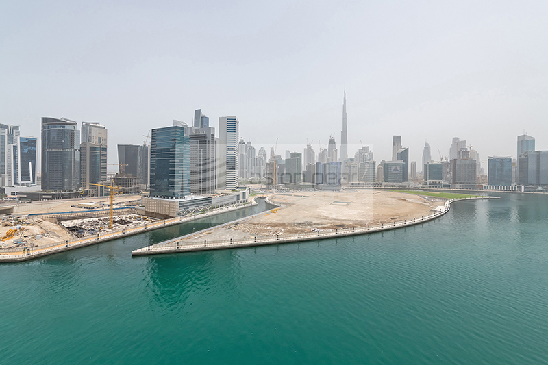Reduced Price | Canal and Burj View | AC Free 2BR